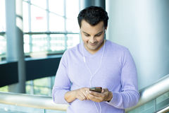 Listening browsing smartphone Royalty Free Stock Photo