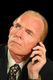 Listening Businessman. Businessman listening intently on his cell phone Stock Photos