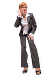 Listening businesswoman. Young businesswoman listening customers isolated Royalty Free Stock Photo