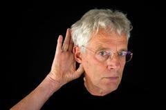 Listening elderly man Stock Images
