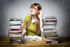 Listening female student. With books Stock Photo