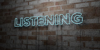 LISTENING - Glowing Neon Sign on stonework wall - 3D rendered royalty free stock illustration Stock Photos