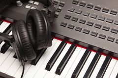 Listening Headphones Laying on Electronic Synthesizer Keyboard Royalty Free Stock Images