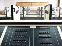 Listening laboratory. A view of a listening laboratory used for language learning with listening booths in the background and a central control panel in the Royalty Free Stock Images