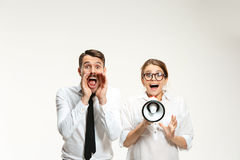 Listening, Megaphone, Shouting. Successful business couple at the office on white background. Listening, Megaphone, Shouting concept Stock Photography
