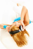 Listening music. Young beautiful happy women listening music in headphones Royalty Free Stock Photo