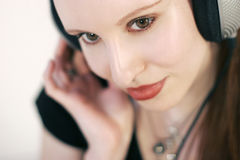 Listening music. A beautiful young woman listen to music with headphones Royalty Free Stock Photos