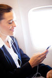 Listening music on airplane Royalty Free Stock Images