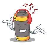 Listening music battery mascot cartoon style. Vector illustration Stock Photos