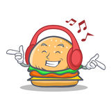 Listening music burger character fast food. Vector art Royalty Free Stock Image