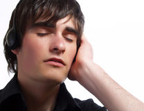 Listening music with closed eyes Stock Photography