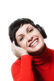 Listening music from headphones Royalty Free Stock Image