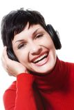 Listening music from headphones Royalty Free Stock Images