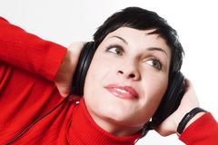 Listening music from headphones Stock Images
