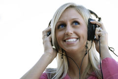 Listening music with headphones Stock Photography