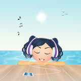 Listening music with headphones Royalty Free Stock Images