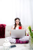 Listening music at home. Young woman relax listening some music at home Stock Image
