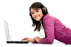 Listening music on a laptop Royalty Free Stock Photos