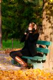 Listening music at park Royalty Free Stock Photography