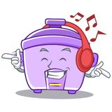 Listening music rice cooker character cartoon Royalty Free Stock Photos