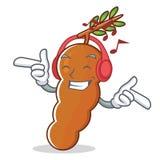 Listening music tamarind mascot cartoon style Royalty Free Stock Image