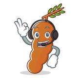 Listening music tamarind mascot cartoon style. Vector illustration Stock Photo