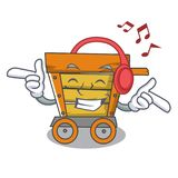 Listening music wooden trolley mascot cartoon. Vector illustration vector illustration