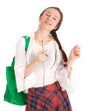 Listening music young woman with shopping bag Stock Image