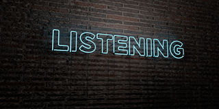 LISTENING -Realistic Neon Sign on Brick Wall background - 3D rendered royalty free stock image Stock Images