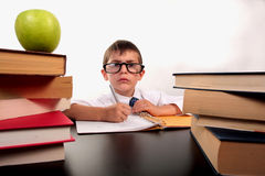 Listening at shool. Little boy suitting at his desk listening in the classroom Royalty Free Stock Image