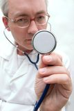 Listening with stethoscope Royalty Free Stock Photography