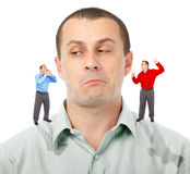Listening to elf-businessmen. Businessman undecided which of his elf businessman advice to follow Stock Photos