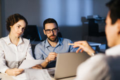 Listening to explanation. Group of architects organizing their work or discussing ideas stock photo