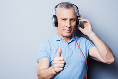 Listening to good music helps you at any situation. Stock Photography