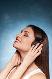 Listening to her favorite music. Stock Image