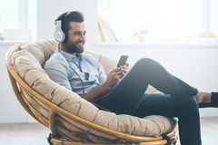 Listening to his favorite music. Stock Photos