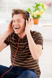 Listening to his favorite music. Royalty Free Stock Photos