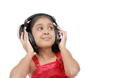 Listening to the Indian music Royalty Free Stock Photography