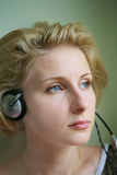 Listening to misic. Young woman listening to misic Stock Photos