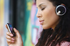 Listening to MP3 player on Royalty Free Stock Photography
