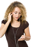Listening to an MP3 player Royalty Free Stock Images