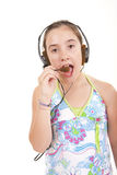 Listening to Music. A young girl listening to music and singing Stock Images