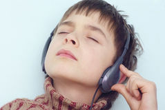 Listening to music. Boy is listening to music Stock Photography