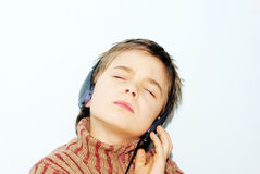 Listening to music. Boy is listening to music stock photo
