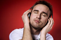 Listening to the music. Young man listening to the music with eyes closed Royalty Free Stock Images