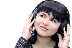 Listening to music. Happy teenage girl in headphones over white Royalty Free Stock Photo