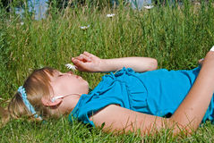 Listening to music. Young girl listening to music in meadow stock photography