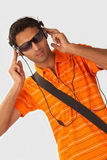 Listening to music. Young Man listening to music with headphones on white background royalty free stock images
