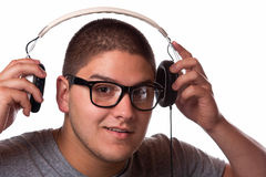 Listening to Music. A young man listens to music with a set of head phones Stock Image