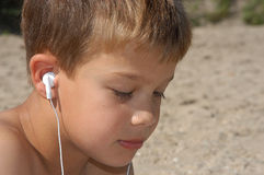 Listening to music. Young boy listening to some music Stock Images